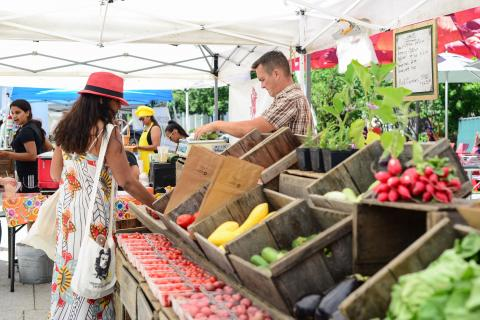 Woman purchasing produce at Farmers' Market