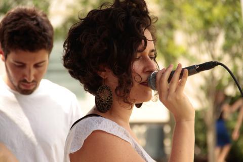 Berklee student singing in an outdoor venue