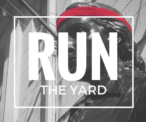 Image of the John Harvard Statue wearing a Harvard Crimson red sweatband like a runner, overwritten with the text RUN THE YARD